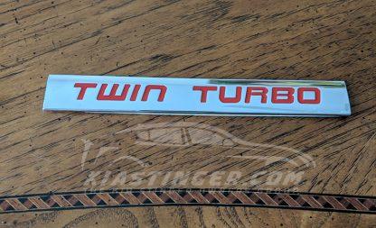 red twin turbo badge