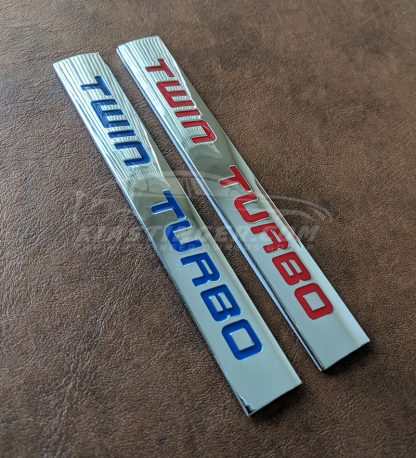 twin turbo badge in red and blue